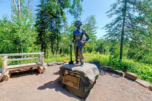 Photo of a statue dedicated to the Civilian Conservation Corps workers who helped develop Gooseberry Falls State Park.