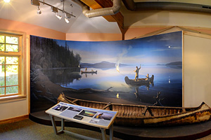 Photo of a mural showing a spring spear fishing scene near the mouth of the Pigeon River.