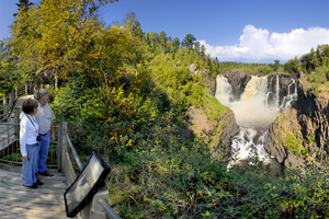 Photo of the stunning view of the High Falls of the Pigeon River, which is Minnesota's highest waterfall, plummeting 120 feet into a narrow rocky gorge.