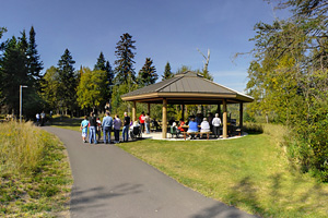 Photo of a picnic shelter offering a good place for a family picnic lunch along a paved trail next to the Pigeon River.