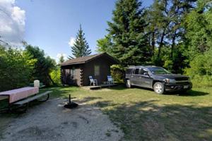 Photo of a camper cabin located near the lake.