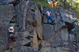 Photo of climbers on the face of the park's basalt rock.