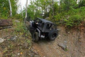 Photo of an off-road vehicle hill climbing a trail called the Ski Jump.