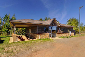 Photo of the training building and picnic shelter located near the entrance of the facility.