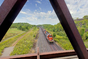 Photo of the railroad bridge, which is a popular spot for people to take photos and watch trains go by during the summer.