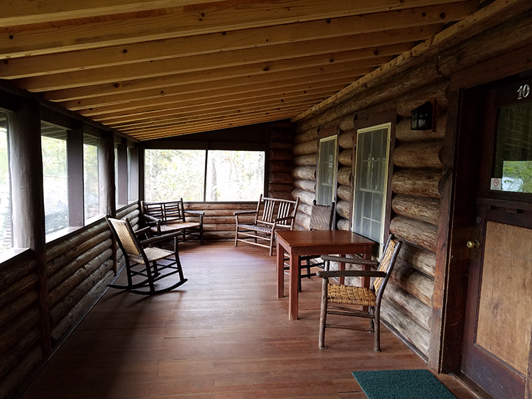 Photo of the covered porch on one of the Douglas Lodge cabins.