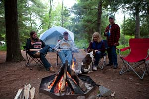 Photo of a family sitting around their campfire.