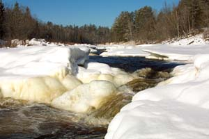 Photo of the St. Louis River under ice in winter.