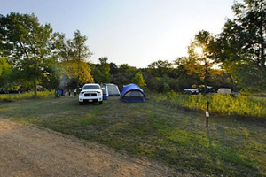 Photo of the seasonal campground offers you a variety of campsites to choose from, including: wooded, open, and sites that overlook the prairie.