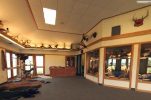 Photo of the interior of the visitor center displays and park ranger office.