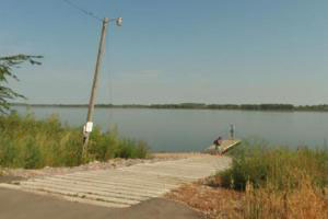 Photo of the park's boat ramp and dock along the shore of Lac qui Parle Lake.
