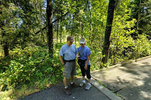 Photo of visitors on the Paul Bunyan State Trail, enjoying this paved route through the woods.