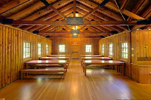 Photo of woodwork and overhead beams, within the Dining Hall.