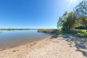Photo of the sandy swimming beach along the shore of Lake Carlos.