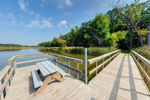 Photo of the wooden fishing pier extending out into Little Mary Lake.