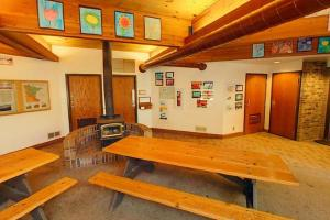 Photo of the Trail Center, which includes a wood stove, picnic tables and restrooms.