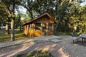 Photo of one of the camper cabins available to rent in Oak Woods Campground.