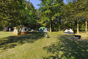 Photo of tent campers using rustic Prairie Campground.