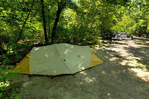 Photo of a tent camper using the middle campground loop for their overnight stay.