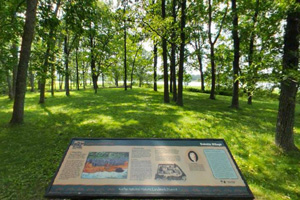 Photo of a interpretive trail featuring historic sites and views of Ogechie Lake.