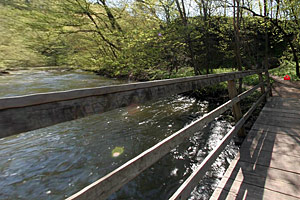 Photo of a wooden bridge that crosses Minneopa Creek.