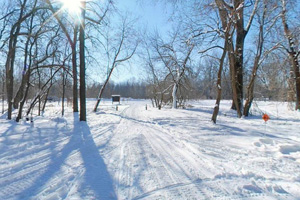 Photo of the park's winter season showing the parking area north of Highway 41.