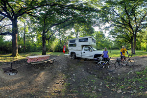 Photo of campers enjoying a campsite that offers electrical service.