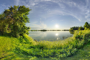 Photo of the shore of Lake Monson along a grassy walking path.