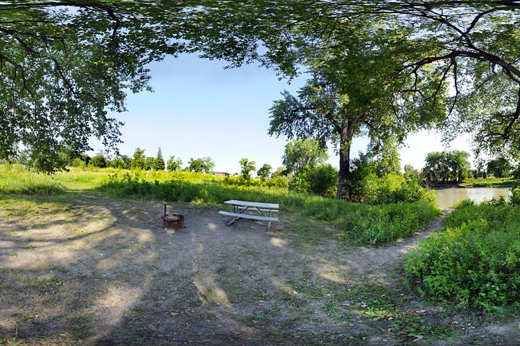 Photo of a walk-in secluded campsite that borders the Red River and can be accessed by a mowed path.