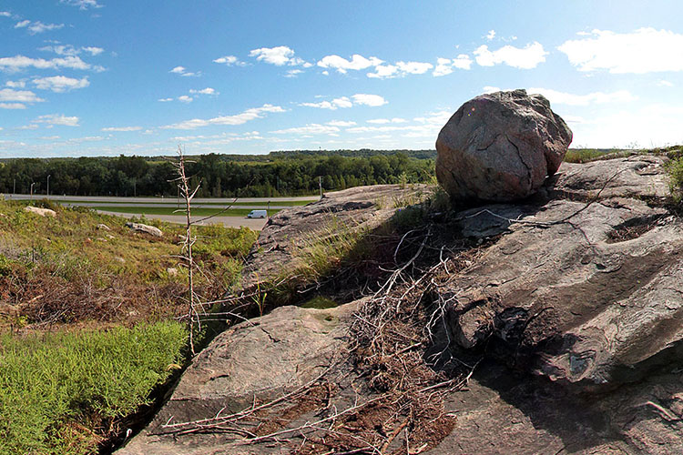 Photo of large rock outcrops upon a massive, high bedrock knob along the Minnesota River.