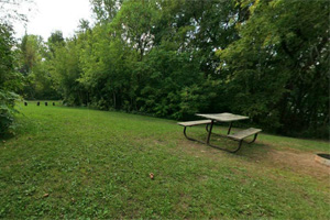 Photo of picnic tables located at the lower group camp site.