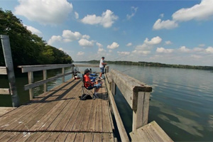 Photo of visitors fishing on the park's fishing pier on Sakatah Lake.