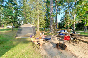 Photo of a family relaxing in the Lodge Campground at Scenic State Park.