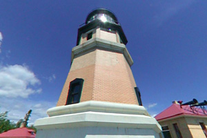 Photo of a historic lighthouse and other structures maintained by the Minnesota Historical Society.