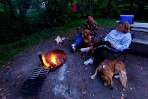 Photo of campers enjoying an evening by the campfire, at the Lower Campground.