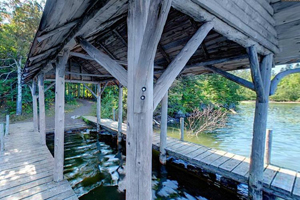 Photo of a historic boathouse on Mic Mac Lake.