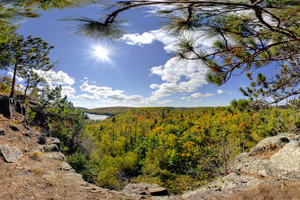 Photo of the Tettegouche Lake Overlook in the foreground with Lake Superior in the distance.