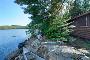 Photo of one of four historic cabins on the shores of Mic Mac Lake and is available to rent year-round.