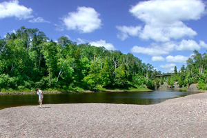 Photo of the mouth of the Baptism River shoreline, that offers carry-in kayak access for the Lake Superior Water Trail.