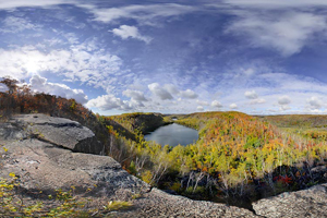Autumn photo of an overlook of Bear Lake, from the Superior Hiking Trail, of rugged and beautiful terrain in the park.