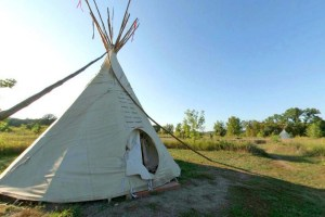 Photo of an 18-foot tipi, which can house up to six campers.