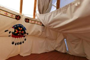 Photo of the canvas interior of a tipi.