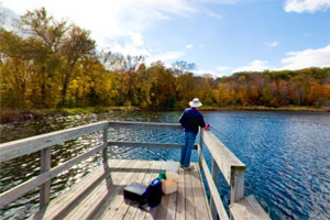 Photo of a man fishing off the end of the fishing pier at William O'Brien State Park.