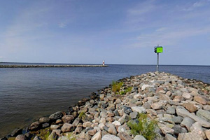 Photo of the stone jetty which protects access at the mouth of the channel between Zippel Bay and Lake of the Woods.