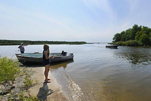 Photo boaters fishing along the shoreline at Zippel Bay State Park.