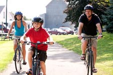 Family bicycling on a state trail.