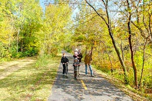 Photo of visitors enjoying a varity of trail uses along the Gateway State Trail?