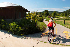 Photo of a biker traveling by the trail head in the town of Houston by the nature center.