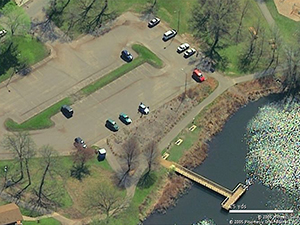 The entire parking lot now drains into bioinfiltration basin. The shoreline was also restored. Photo: Dakota County Soil and Water Conservation District.