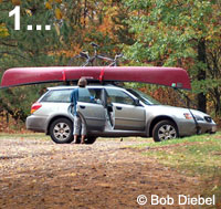 Photo of a car with canoe and bicycle on its roof